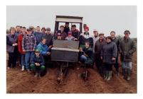 Members and parents of Bryngwyn Y.F.C. sowing...