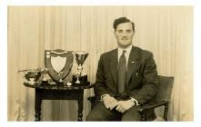 Lloyd Jones with trophies for public speaking,...
