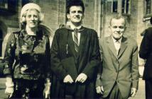 Man with his parents on graduation day