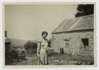 Betha Hughes feeding the chickens at Bryn Hope...