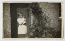 Betha Hughes and the cat at Bryn Hope farm,...