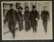 David Lloyd George accompanied by a Suffragette