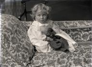 Portrait of a very young child sitting on a...