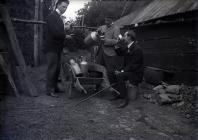 Three men drinking milk