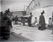 Cockle sellers outside Carmarthen Market.  c. 1900