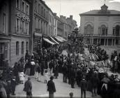 A circus parade in Guildhall Square, Carmarthen