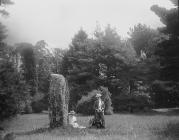 Two ladies by a standing stone