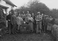 Group of people with a golfing trophy
