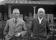 Two men outside Llandrindod Wells Golf Club...