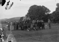 Group of men on a golf course with green...