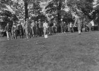 Golfers and spectators on the fairway