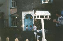 Family outside their home, 1997