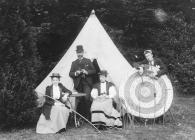 Two men and women with archery equipment, c.1910