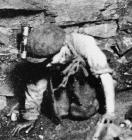 A young boy working underground