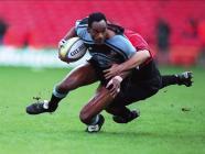 Nigel Walker tackled by Phillippe Carbonneau,...
