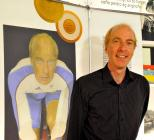 The cyclist Simon Richardson with a painting of...