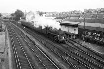 4-6-0 75070 + train passing BRS Depot, Hove,...