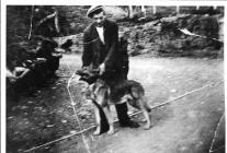 Quarryman, Tom Rowlands with his dog Prince.