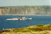 The paddle steamer Waverley passing between...