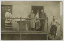Morris Hughes butchering carcasses