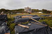 The Skokholm meadow piled with building materials