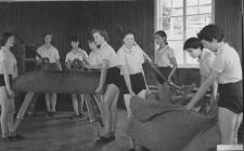 Pupils moving Physical Education equipment,...