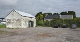 Barn with Eglwys Brewis church in background,...