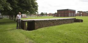 Brian Acott beside air raid shelter, RAF St...