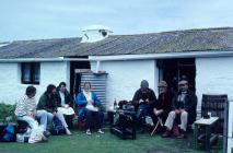 Skokholm - Various people sitting outside the...