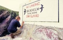 Skokholm - Repainting the 'No-Landing' sign