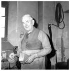 George Scammell in his workshop at Union Road,...