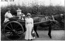 Women delivering milk by horse and cart