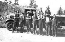 Workmen poss at quarry near hairpin bend Bwlchgwyn