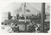 Eisteddfod Gaiman 1933, in a tent.  Presenter...