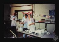 Photograph of cooks in kitchen for the...