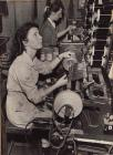 Photo: Marge Evans sitting at her coil-making...
