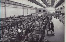 Workers - men and women - in Switchgear factory...