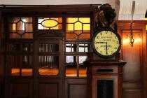 Lion holding tide-time clock