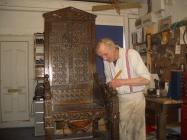Hugh Haley repairing the Black Chair