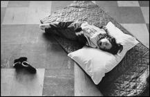 A Young Ely Hospital patient resting on the floor