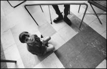 Young Ely Hospital Patient Looks Up from Floor