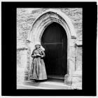Woman in porch of Llangynwyd Church, West Doorway