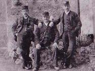 Men outside The North Wales Hospital, Denbigh