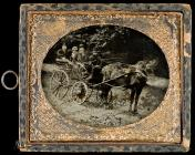 Open horse-drawn carriage with four people