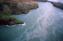 Aerial photograph of oil on the sea following...
