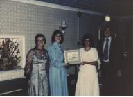 Catrin Stevens being presented with a gyft from...