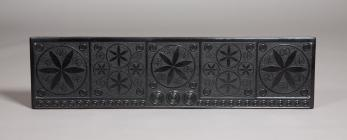 A carved slate chimney piece or mantle