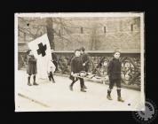 Photograph of boys with a Red Cross banner and...