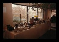 A photograph of a pottery exhibition in St....