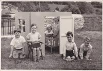 Children playing in a Wendy House at Cwmdu School.